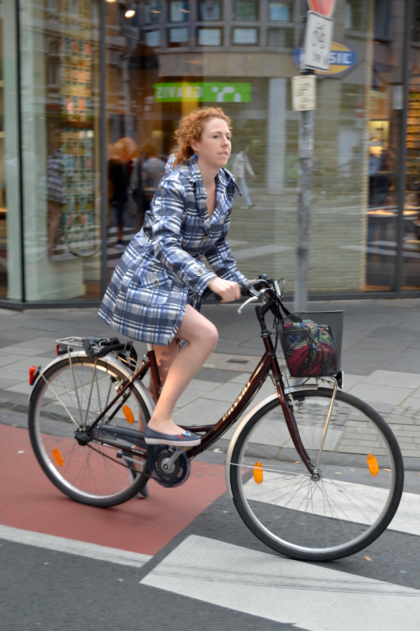 Unknown bicycle girl on Apostelnstraße, Cologne, Germany, Coat, streetstyle, fashion, fashionista, bicycle, red hair, culrs, girl, cute, sneaky shot, plaids, blue, www.thisishype.com, thisishype.com, thisishype, This Is Hype, 2012, cool, stylish, chic,
